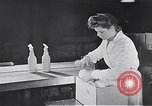 Image of liquor bottle United Kingdom, 1950, second 36 stock footage video 65675032848