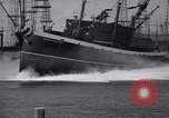 Image of cargo vessel Long Beach California USA, 1941, second 25 stock footage video 65675032898