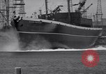 Image of cargo vessel Long Beach California USA, 1941, second 28 stock footage video 65675032898