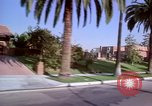 Image of Palm tree lined street in neighborhood Los Angeles California USA, 1976, second 12 stock footage video 65675033263