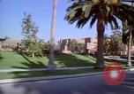 Image of Palm tree lined street in neighborhood Los Angeles California USA, 1976, second 14 stock footage video 65675033263