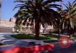 Image of Palm tree lined street in neighborhood Los Angeles California USA, 1976, second 17 stock footage video 65675033263
