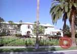 Image of Palm tree lined street in neighborhood Los Angeles California USA, 1976, second 33 stock footage video 65675033263