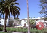 Image of Palm tree lined street in neighborhood Los Angeles California USA, 1976, second 35 stock footage video 65675033263