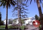 Image of Palm tree lined street in neighborhood Los Angeles California USA, 1976, second 37 stock footage video 65675033263