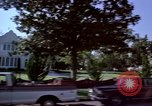 Image of Palm tree lined street in neighborhood Los Angeles California USA, 1976, second 44 stock footage video 65675033263