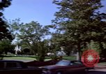 Image of Palm tree lined street in neighborhood Los Angeles California USA, 1976, second 45 stock footage video 65675033263