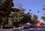 Image of Palm tree lined street in neighborhood Los Angeles California USA, 1976, second 46 stock footage video 65675033263