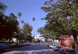 Image of Palm tree lined street in neighborhood Los Angeles California USA, 1976, second 47 stock footage video 65675033263