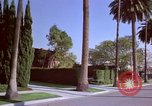 Image of Palm tree lined street in neighborhood Los Angeles California USA, 1976, second 58 stock footage video 65675033263