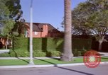 Image of Palm tree lined street in neighborhood Los Angeles California USA, 1976, second 61 stock footage video 65675033263