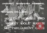 Image of British unemployed people march in protest United Kingdom, 1932, second 1 stock footage video 65675033280