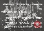 Image of British unemployed people march in protest United Kingdom, 1932, second 2 stock footage video 65675033280