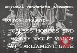 Image of British unemployed people march in protest United Kingdom, 1932, second 3 stock footage video 65675033280