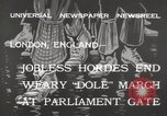 Image of British unemployed people march in protest United Kingdom, 1932, second 5 stock footage video 65675033280
