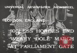 Image of British unemployed people march in protest United Kingdom, 1932, second 6 stock footage video 65675033280