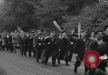 Image of British unemployed people march in protest United Kingdom, 1932, second 20 stock footage video 65675033280