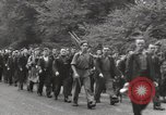 Image of British unemployed people march in protest United Kingdom, 1932, second 29 stock footage video 65675033280
