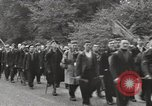 Image of British unemployed people march in protest United Kingdom, 1932, second 32 stock footage video 65675033280