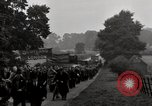 Image of British unemployed people march in protest United Kingdom, 1932, second 50 stock footage video 65675033280