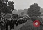 Image of British unemployed people march in protest United Kingdom, 1932, second 59 stock footage video 65675033280