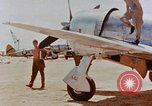 Image of P-47N Thunderbolts of the 464th Fighter Squadron Ryukyu Islands, 1945, second 1 stock footage video 65675033358