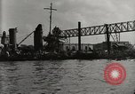 Image of Wrecked ships Pearl Harbor Hawaii USA, 1942, second 16 stock footage video 65675033415