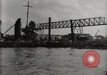 Image of Wrecked ships Pearl Harbor Hawaii USA, 1942, second 18 stock footage video 65675033415