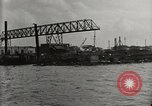 Image of Wrecked ships Pearl Harbor Hawaii USA, 1942, second 25 stock footage video 65675033415