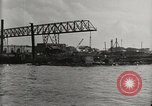 Image of Wrecked ships Pearl Harbor Hawaii USA, 1942, second 26 stock footage video 65675033415