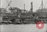 Image of Wrecked ships Pearl Harbor Hawaii USA, 1942, second 28 stock footage video 65675033415