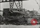 Image of Wrecked ships Pearl Harbor Hawaii USA, 1942, second 32 stock footage video 65675033415
