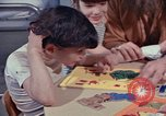 Image of modifying behavior of mentally disabled Kansas United States USA, 1975, second 42 stock footage video 65675033443