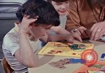 Image of modifying behavior of mentally disabled Kansas United States USA, 1975, second 43 stock footage video 65675033443