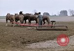 Image of Farmer with horses and mules plows field New York United States USA, 1970, second 8 stock footage video 65675040536