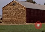 Image of Barn in a field New York United States USA, 1970, second 49 stock footage video 65675040542