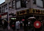 Image of Shops and stores along street of New York City New York City USA, 1970, second 11 stock footage video 65675040546