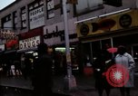 Image of Shops and stores along street of New York City New York City USA, 1970, second 12 stock footage video 65675040546
