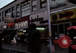 Image of Shops and stores along street of New York City New York City USA, 1970, second 13 stock footage video 65675040546