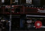 Image of Shops and stores along street of New York City New York City USA, 1970, second 36 stock footage video 65675040546
