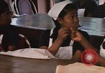 Image of Needlework and sewing class Kingston Jamaica, 1972, second 55 stock footage video 65675040547