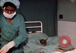 Image of baby delivery Kingston Jamaica, 1972, second 14 stock footage video 65675040549