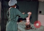 Image of baby delivery Kingston Jamaica, 1972, second 36 stock footage video 65675040549