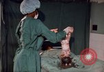 Image of baby delivery Kingston Jamaica, 1972, second 37 stock footage video 65675040549