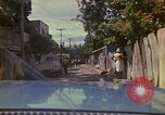 Image of narrow streets Kingston Jamaica, 1972, second 1 stock footage video 65675040554