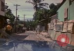 Image of narrow streets Kingston Jamaica, 1972, second 4 stock footage video 65675040554