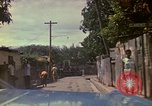 Image of narrow streets Kingston Jamaica, 1972, second 7 stock footage video 65675040554