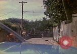 Image of narrow streets Kingston Jamaica, 1972, second 8 stock footage video 65675040554