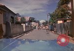 Image of narrow streets Kingston Jamaica, 1972, second 17 stock footage video 65675040554