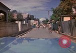 Image of narrow streets Kingston Jamaica, 1972, second 18 stock footage video 65675040554